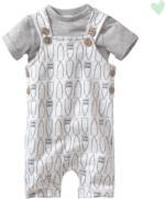 Newborn-Spieler und T-Shirt